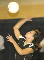 by: David Ball, Reynolds junior Savanah Montanona serves a ball during the Raiders' five-game playoff loss in Canby on Wednesday night.