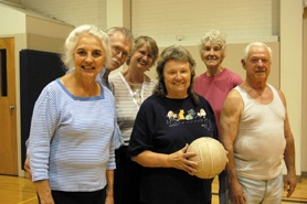 by: Barbara Adams, Shirley Hall (from left), Doug Barnes, Bert Yates, Sue Barnes, Phyllis Grimm and Marvin Harper play community volleyball year round through the Estacada Community School.