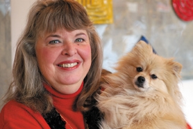 by: Barbara Adams, Linda Owens is known for her beautiful stained glass art. She's also frequently seen with her Pomeranian, Winston, who often tags along.