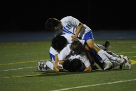 by: Vern Uyetake, Members of the Lakeridge boys soccer team pile on top of Corey Rosenfeld after he scored a goal during Tuesday's playoff game against Southridge. The Pacers, who are undefeated this season, trailed two times in the contest, at 2-1 and 3-2. Lakeridge then scored four unanswered goals to claim a 6-3 victory. The Pacers will now host a third-round game on Saturday.