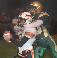 by: Vern Uyetake, Beaverton safety Alex Corona intercepts a pass intended for West Linn's Josh Oltman late in the game, ending another Lion possession with a turnover Friday night.