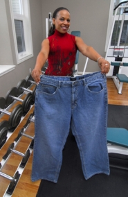 by: Vern Uyetake, Lake Oswego resident Camille Tirzah holds up a pair of jeans she wore three years ago. Tirzah lost 100 pounds and has recently started up a venture to help other individuals who want to live healthier.