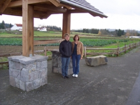 by: Submitted photo, Jayne Cronlund, left, and Cary Strauch stand at the kiosk on Stafford Road where bricks will be placed to celebrate the Stafford Basin Trail.