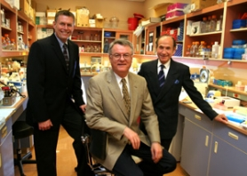 by: JIM CLARK, Calvin Harrison (from left), Walter Urba and Albert Starr are starting to formulate a budget for Providence hospital's young but growing research program.
