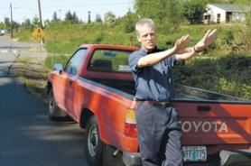 by: Carole Archer, John Tidswell shows where his pickup was parked before it was towed last year, costing him $241.
