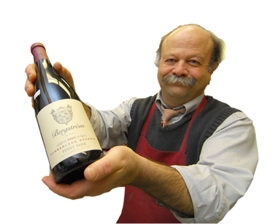 by: VERN UYETAKE, Tom Reider at Wizer's Oswego Foods often helps customers with wine selections.