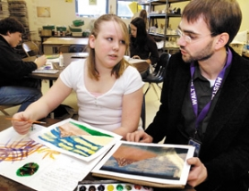 by: Carole Archer, Walt Morey Middle School art teacher Carson Abbert, right, helps seventh-grader Chelsy Grover with her watercolor rendition of Japan's Mt. Fuji on Friday, Dec. 1.