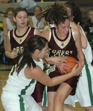by: Zack Palmer, Forest Grove's Sarah Amina fights for a loose ball with Sam Dewart of West Linn on Tuesday night in a non-conference girls basketball game.
