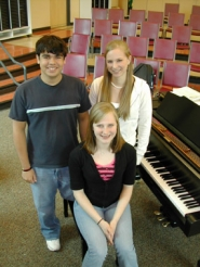 by: Jim Hart, Three West Linn High School seniors were chosen by audition to the All Northwest Jazz Choir, and will perform in February with very challenging music at venues in Portland. Pictured in the high school's choir room are Tenor Adam Pettitt, Alto Nina Dalgaard, standing, and soprano Marta Hanson.