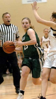 by: DAN BROOD, BIG GAME — Tigard sophomore guard Corinn Waltrip drives to the basket in Saturday's game. Waltrip had 10 points, five assists and five steals in the 66-18 win.