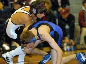 by: DAN BROOD, BACK FOR THE BOWMEN — Sherwood High School sophomore Kaleb Gilgan (left), shown here wrestling in a match last year, is one of the key returnees for the Bowmen for the 2006-2007 season.