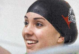 by: JAIME VALDEZ, WINNING SMILE — Tualatin's Amy Herbst swam to first place in the 50-yard freestyle in last week's meet.