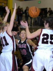 by: JOHN LARIVIERE, UNDER PRESSURE – Tualatin's Jen Gruss (30) is trapped by Southridge's Falissa Smith and Danielle Wells.