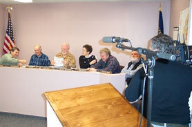 by: Bob Schoenberg, Left to right: Councilors Sam Locklin, Ray Robinson, Ron Shay, Brenda Wilkinson, Jim Gates and Dick Winn prepare for their holiday close up with TVCTV producer Dave Slay.