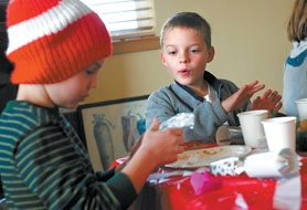 by: Jonathan House, INSIDE THE POPPERS — MITCH third-grader Jack Klin (right) excitedly watches as Jonathan Irving opens a gift that was inside his popper during a Scandinavian Christmas celebration.