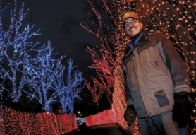 by: JAIME VALDEZ, As event technical coordinator at the Oregon Zoo, Russell Guinn is in charge of the 900,000 lights that illuminate the holiday ZooLights festivities. More than half the lights are energy-efficient LEDs.