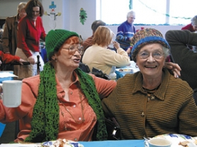 by: , An annual holiday party at Friendly House caters to the senior crowd.