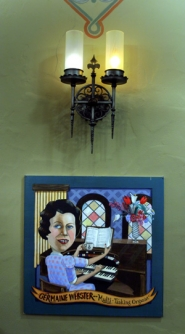 by: JIM CLARK, The transformation of Little Chapel of the Chimes mortuary shows the trademark McMenamins redo: original fixtures, such as a sconce by iron artist O.B. Dawson, contrast with modern pieces celebrating the building's history, in this case a portrait of longtime organist Germaine Webster.