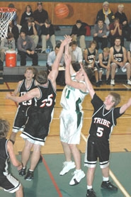 by: Clinton Vining, Estacada sophomore Houston Webb shoots for two over Scappoose's Josh Nelson.