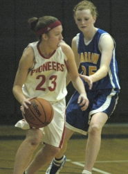 by: David Ball, Sandy's Michaela Hillis drives away from a Barlow defender.