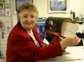by: Marcus Hathcock, Gail Gannon makes sure letters to Santa at the Sandy Post Office make it to the North Pole.