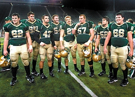 "by: JAIME VALDEZ, THE FRANCHISE — Jesuit's line, AKA ""The Franchise,"" included (left to right) Nick Lewis, Mike Remmers, Sean Williams, Mike Lamb, fullback Owen Marecic, Adam Kleffner, Aaron Campbell and Ryan Heffernan helped their team average 338 yards rushing per game in the 2006 season."
