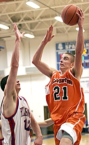 by: MILES VANCE, UP AND OVER — Beaverton senior David Mabry soars over Hillsboro's Kyle Meeuwsen during the Beavers' 69-65 win at Hillsboro on Friday night.