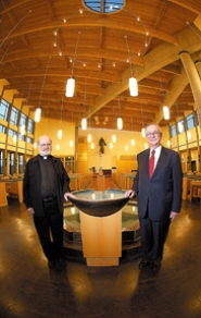 by: Jaime Valdez, DIVINE DESIGN — Father William Moisant (left) and Richard Akins stand in the entranceway of the Catholic Church of the Resurrection, which was recently recognized in a book about church architecture.