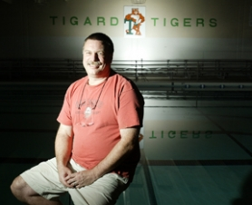 by: Jaime Valdez, UNDERWATER JOB — The Tigard Swim Center is Andy Carlisle's home away from home, as he coaches swim club swimmers almost 18 hours a week in addition to coaching the THS swim team and teaching lessons at the Tualatin Swim Center.