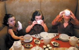 by: DENISE FARWELL, Lemonade and hot cocoa taste good to the last drop — especially if served in teacups — as shown by Beatrice Gorsuch, 7 (right), and friends Natalie Galbraith, 5 (middle), and her sister Olivia, 3. The tiny sandwiches, cakes and crackers also disappear quickly.