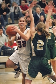 by: vern Uyetake, Lake Oswego's Margaret Johnson puts up the game-winning basket with 29 seconds remaining in Friday's showdown with Jesuit. Johnson was fouled and made the three-point play, giving the Lakers the lead for good in a 56-54 win at home.