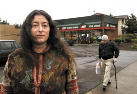 by: Jim Clark, Erika Silver of the nonprofit Human Solutions can see several payday loan businesses from her office, near Southeast 122nd Avenue and Powell Boulevard. Advocates for the homeless and low-income people say the firms have found a way around recent legislation aimed at curbing lending practices seen as predatory.