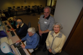 "by: Vern Uyetake, Bob Eick and Esther Wood were two of seven Lake Oswego residents honored Tuesday in a civic ceremony for Unsung Heroes. Catharin Ayers (seated) has benefited from instruction in the Lake Oswego Adult Community Center computer lab with volunteers Eick and Wood. She said both help seniors acclimate to computers in a friendly environment. ""People our age are interested but they're a little intimidated. And these guys are good,"" she said."