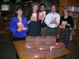 "by: Matt Sherman, From left, organizers Cyndie Glazer, Kiera Taylor, Todd Feinman, Bill Baars and Jane Carr pose in the Lake Oswego Public Library with copies of ""The Shadow of the Wind,"" the inaugural selection for the Lake Oswego Reads program."