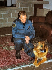 "by: , It was just one year ago, February 2nd of 2006, when he had accepted that year's ""K-9 of the Year"" award for his partner, that Officer Shawn Gore then posed with Deny at Southeast Precinct for the BEE camera."