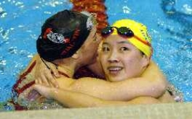 by: DAN BROOD, NICE RACE — Tualatin junior Hannah Points (left) and Barlow's Jacqueline Leung congratulate each other following the 200 individual medley race. Points won the race in a time of 2:04.68.