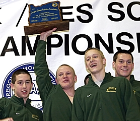 by: MILES VANCE, THEY'RE THE BEST — Jesuit senior Quincy Lee hoists the Class 6A state trophy aloft after his team won its second straight big-school championship on Sunday. He is joined by teammates (from left) Sam Conchuratt, Joey Bieze and Garth Summers.