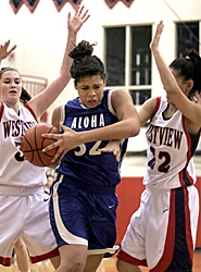 by: JONATHAN HOUSE, WORKING IT — Aloha's Cassandra Tiggett drives through the Westview defense last Thursday night.