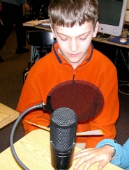 by: Ray Pitz, Brendan Withycombe reads for an upcoming school podcast at West Tualatin View Elementary School.