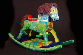 "by: Submitted photo, HORSIN' AROUND FOR CHARITY — This rocking horse painted by Jill Jeffers Goodell, of Tigard, is for sale and proceeds will benefit the Children's Relief Nursery in Portland. The creation is entitled, ""A Horse of Different Impressions."""