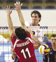 by: ©2006 MICHAEL BRANDY, Ryan Millar of the U.S. volleyball team spikes the ball past Lukasz Kadziewicz of Poland during a match last summer in West Valley, Utah.