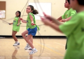 by: Jonathan House, SKIP AWAY — Megan Robinson, a third-grader at St. Anthony School in Tigard, performs with the St. Anthony Jump Rope for Heart demo team during a rally Friday at the school.