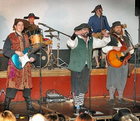 "by: David F. Ashton, Captain Bogg works the crowd at the Westmoreland Llewellyn School benefit, saying, ""Give me the first 'group-Arrrr' ever heard in the Moreland Theater!"""