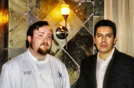 by: Rita A. Leonard, At Brooklyn's new Blue Dragonfly Restaurant, Chef John Willis (left) and Manager Rafael Rodriguez stand in the downstairs Lounge.