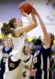 by: Chase Allgood, Forest Grove's April Maslen gets her shot blocked by Jamie Jo McGraw of Canby during last Friday's Pacific Conference regular-season finale.