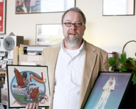 by: Chase Allgood, Steve Klein displays two of the hundreds of albums he's collected over the past 35 years.