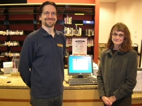 by: Cliff Newell, Audio-visual Librarian Greg Williams and Co-Library Director Linda Malone are pictured in the West Linn library.