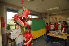 by: Vern Uyetake, William Wirtz and Emily Brother lead the parade featuring 15-foot-long Chinese dragon.