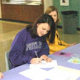 by: DAN BROOD, ON THE DOTTED LINE — Tigard High School senior Kristen Kelly recently signed a letter of intent to play women's college soccer at the University of Portland.