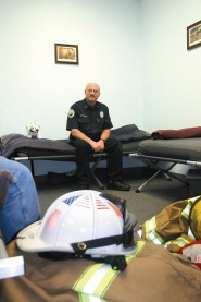 by: Garth Guibord, These cots and bedrolls show by Hoodland firefighter Kim Weaver could end up in better quarters and firefighters could get better rest when the district upgrades its sleeper program.